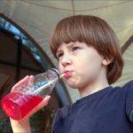 boy drinking soda
